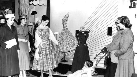 Anne Rayment modelling the polka dot dress in Rossiters fashion department in 1957 (PR25722)