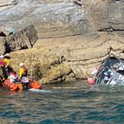 Torbay RNLI lifeboat crew members at the scene where a boat sank near Torquay on Tuesday afternoon.