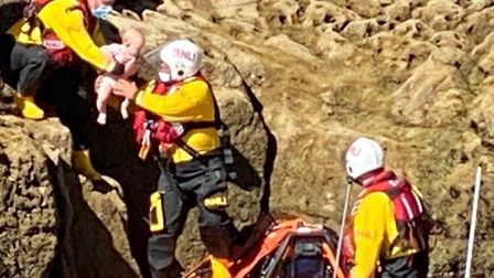 A baby is rescued by a Torbay RNLI lifeboat crew near Torquay. Photo: RNLI Torbay