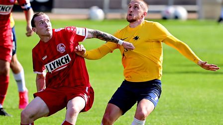 Connor Lemonheigh-Evans of Torquay United challenges for the ball with Jacob Cook of Hemel Hempstead