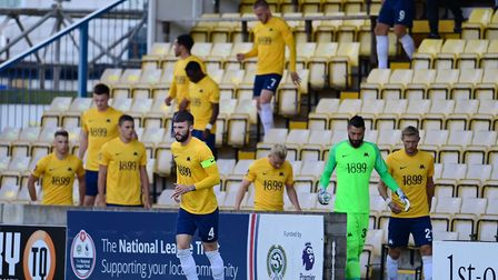 Torquay United players arrives from the members' bar, being used as the home changing room during pr