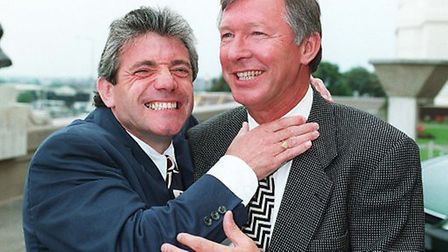 Kevin Keegan (left) gets to grips with Manchester United manager Alex Ferguson. 1996
