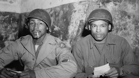 4/16/1944-Italy: Sgt. Charles Glasco, Westchester, PA (l) and Sgt. Audrey Barnes, Chicago, IL, read