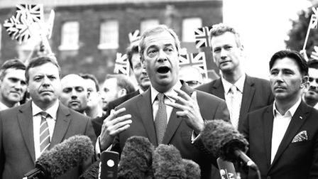 Farage, supported by Arron Banks (left)