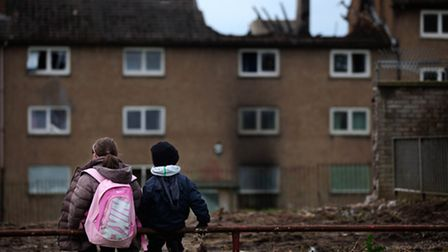 Children make their way home from school in the Easterhouse housing estate in Glasgow, 2010.