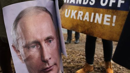 Demonstrators gather outside the Russian Embassy in Vilnius, Lithuania, to protest against Russian i