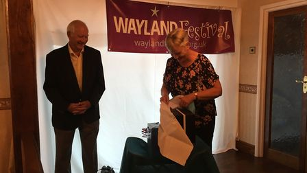 Chairman of The Wayland Festival, John Kerr and the festival's secretary, Judy Kerr are presented wi