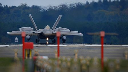 An F-22 Raptor from the 1st Fighter Wing, Joint Base Langley-Eustis, Virginia lands at RAF Lakenheat