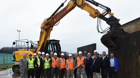 Representatives from RAF Lakenheath during a demolition ceremony at the base. The construction site