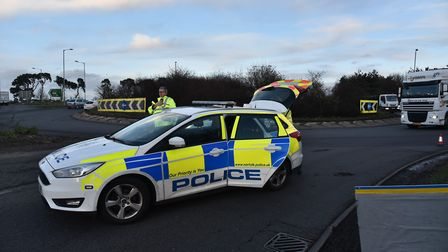 PC David Sayer and PC Amy Lucas stop traffic on the A11 at Thetford following a collision involving