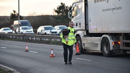PC David Sayer Closing a lane of the A11 due to an incident. Picture: Sonya Duncan