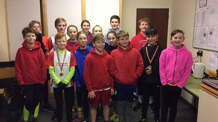 Thetford Athletics Club youngsters who competed in the County Championships face the camera. Turn in