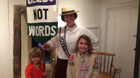 Indigo and Rosie Buckingham, aged 4 and 7, pictured with suffragette Kitty Wilaby (Kathy Hipperson).