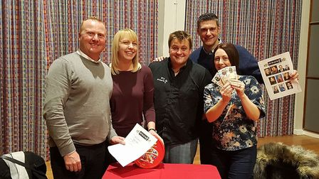 Quizmaster Ricky Jermy pictured with the winning team The Wooden Spoons. Picture: Old Skool Bar