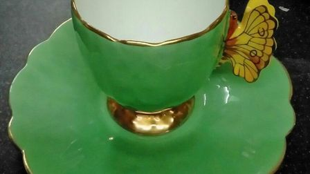 A cup and saucer from the butterfly-themed Aynsley pottery set which was sold by EACH on eBay. Pictu