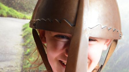 A visitor trying on a Viking helmet at the museum. Picture: Ancient House Museum