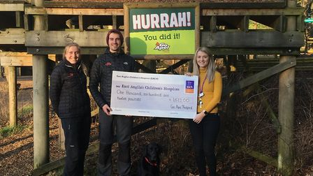 Go Apes Victoria Herbert and Dan James, Peggy the dog, present a cheque for £1,612 to Sophie Mayes f