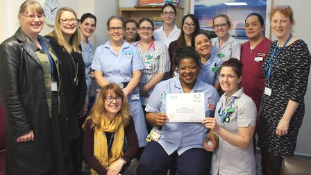 The team on ward G4, the frail elderly ward, receive their Suffolk Family Carers silver award at Wes