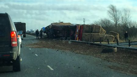 The overturned lorry which is causing delays on the A11 at Larling. Picture: Rob Allanson