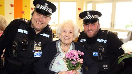 PC Mark Ellis (left) and Special Constable Adam Burroughs from Suffolk police delivering flowers to
