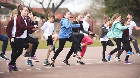 Sprinter Deji Tobais held fun exercise sessions with pupils at the Admirals Academy in Thetford. Pic