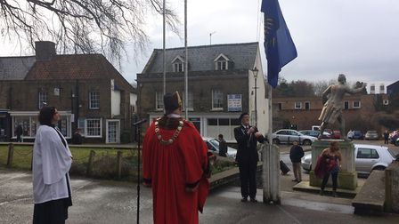 The Commonwealth Flag is raised by Royal British Legion Thetford branch chairman Roger Smith. Pictur
