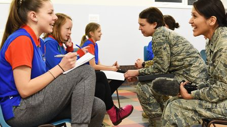 Female officers from the 48th Fighter Wing at RAF Lakenheath mentor young girls from 2nd Mildenhall