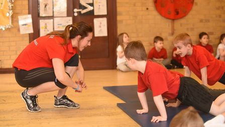 Former Olympic swimmers Joe Roebuck and Amy Smith visited pupils at the Norman School in Northwold a