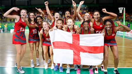 The England netball team celebrate winning gold in the Netball at the Commonwealth Games. Picture M