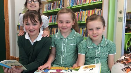 Weeting Primary School celebrates the opening of its refurbished library. Pictured from left: Erin S