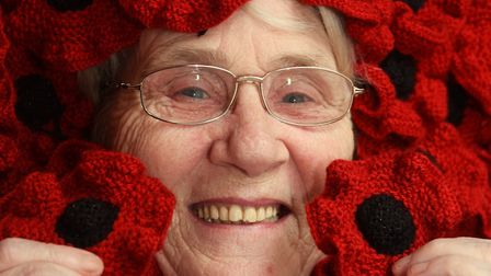 Councillor Brenda Canham with some of the 200 poppies she has already knitted for the Thetford Town