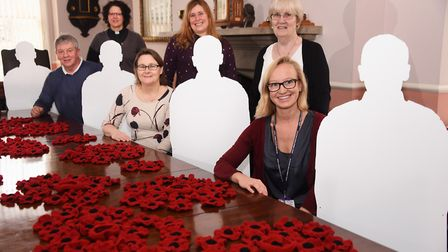 Silhouette Tommies and knitted poppies at Thetford Town Council as their World War One Remembrance e