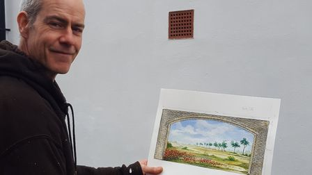Artist Mark Harper with the image he will turn into a mural on the Shambles in Thetford's Market Pla