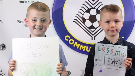 Charlie Johnstone and Archie Murdoch with their posters at the Brandon Town Community Football Club'