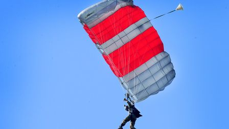 A pararescuemen assigned to the 57th Rescue Squadron makes his final jump over RAF Lakenheath. Pictu