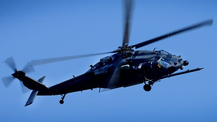 An HH-60G Pave Hawk assigned to the 56th Rescue Squadron flies over RAF Lakenheath in support of the