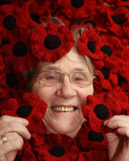 Councillor Brenda Canham with some of the poppies she has knitted for the Thetford Town Council's Fi