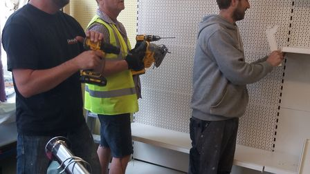 Staff from OMAR donate their time to help refurbish the Brandon Day Care Appeal shop. Picture: Brand