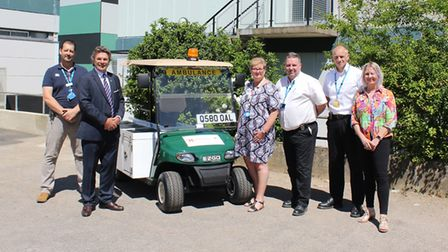 Pictured with the medical buggy from left: Barry Moss, head of emergency preparedness, resilience an