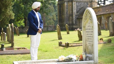 Actor Satinder Sartaaj laying flowers on the grave of Duleep Singh in the churchyard at Elveden Chur