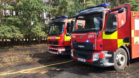 Crews from Suffolk and Norfolk Fire and Rescue Services attended a hay field fire in Brandon. Pictur