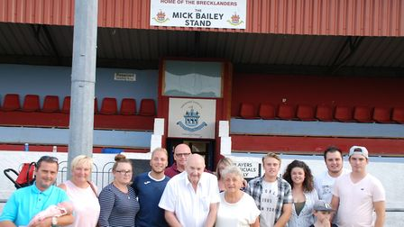 Mick Bailey with his wife Pauline and their family. Thetford Town FC have named the stand in Mr Bail