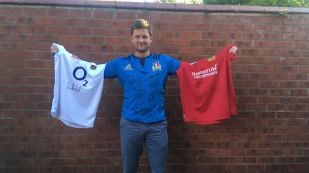 Mark Laws, who has organised the record and charity challenge, with signed rugby shirts which will b