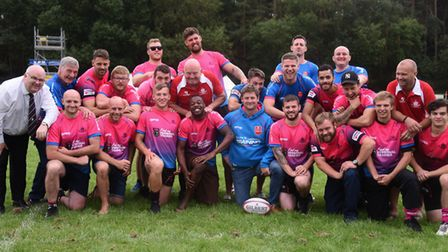 Thetford Rugby Club team, with organiser Mark Laws (centre, front row) in good spirits despite losin