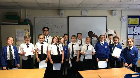 Mandarin Teacher Will (Yu) Liao with year six students from Iceni Academy at their Hockwold site. Pi