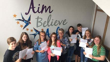IES Breckland GCSE students with principal Alison Tilbrook. Picture: Rebecca Murphy