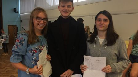 IES Breckland students Chloe Bilverstone, Jorge Lee-Small and Jade Nelson, with their GCSE results.