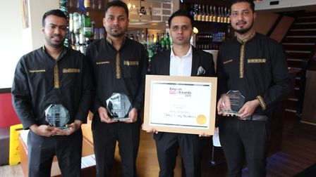 Jay Ali and the team at the Spice Lounge show-off their 2017 award. Picture: The Spice Lounge