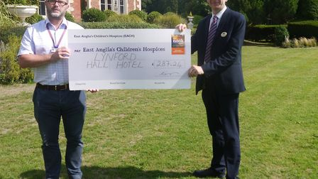 The cheque presented to EACH from Lynford Hall Hotel. Picture: Lynford Hall Hotel