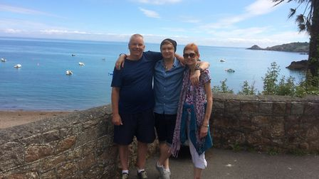 Jason Rayment with his parents Julie and Chris on holiday in Jersey last year. Picture: Rayment fami